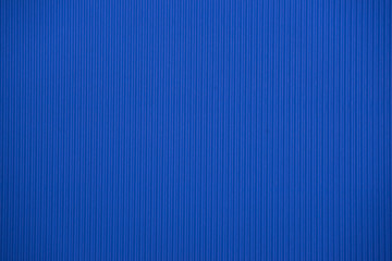 Dark blue colored corrugated cardboard texture useful as a background
