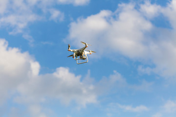 Drone hovering against clear blue sky