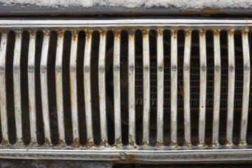 Radiator grille of retro car. Front view