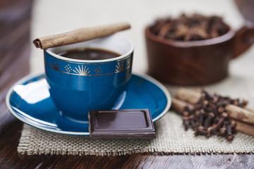 Defocused cup of black coffee on wooden table