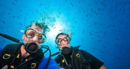 Couple of scuba divers, portrait photography