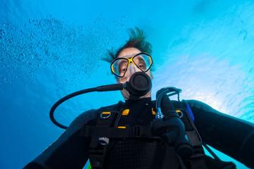 Young man scuba diver selfie