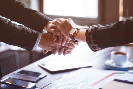 Business trust commitment which Business Partners holding hands,Help, trust ,support ,empathy and factors relationship marketing for reach successful achievement,Trust and commit concept.
