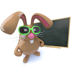 3d Cute chocolate Easter bunny rabbit standing at a blackboard