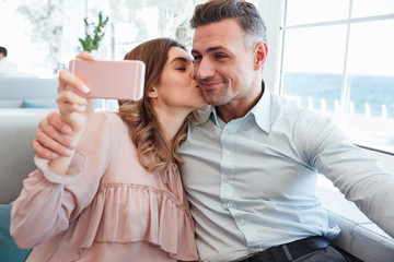 Portrait of a beautiful young couple taking a selfie
