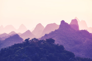 Scenic sunset over Karst mountains in Guilin, one of China top tourist destinations. Color toned picture.