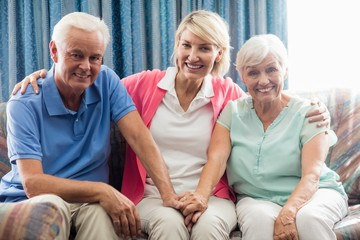 Nurse sitting between a senior couple