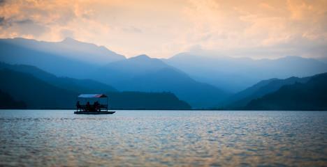 boat on Phewa lake enjoying their trip at sunset. Nepal.