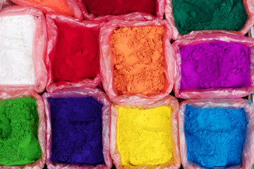 Colorful rangoli powder for sale on Kathmandu street market, Nepal