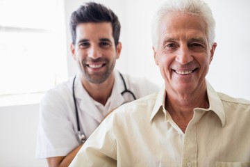 Smiling nurse and senior man
