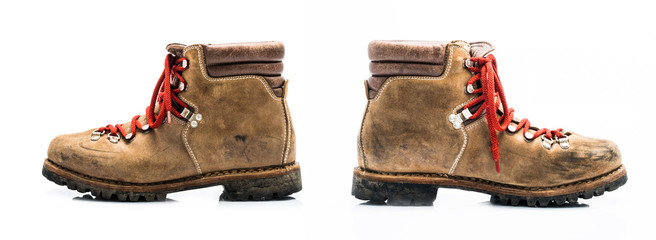 Two old leather mountain shoe isolated on white background