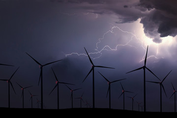 Storm Night Over Wind Farm. Energy and nature Night Sky.