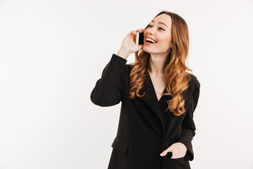 Gorgeous pleased woman having brown beautiful hair talking on mobile phone and having pleasant talk, isolated over white background