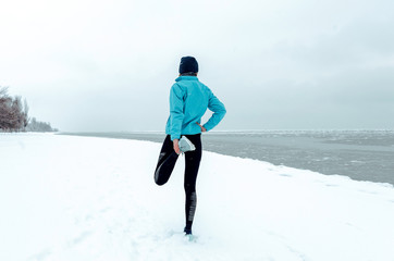 winter running on the snow-covered beach. The concept of a healthy lifestyle and sport regardless of weather and season
