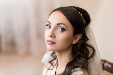 Close-up of the bride. Morning of the bride. Portrait. Makeup. Hairstyle.