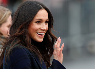 Meghan Markle, fiancee of Britain's Prince Harry, waves as she arrives for a visit to Edinburgh