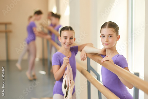 2405e11a315a Beautiful teen ballerina leaning on barre. Cute young girls dancers ...