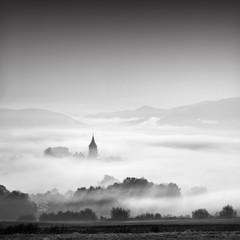 Church in misty autumn morning, rural scenery, christianity, pray concept photo
