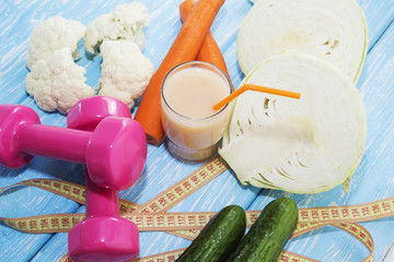Fitness concept with dumbbells and healthy food.