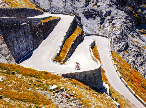Biker on the road - Cyclist photo. Tour, Italy, Passo dello Stelvio