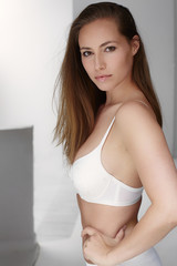 Seriously beautiful woman in bra, portrait