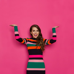 Beautiful Woman In Vibrant Clothes Is Holding Hands Raised And Laughing