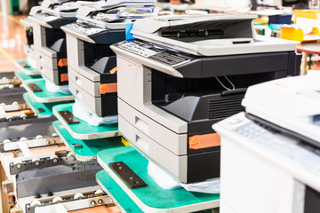 new assembled copiers in line in factory