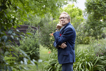 Pensive man in the garden