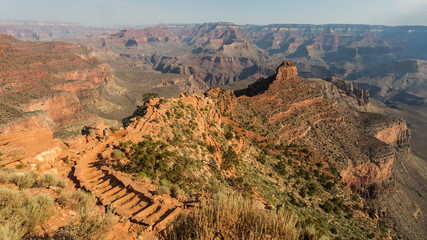 The Grand Canyon is a steep-sided canyon carved by the Colorado River in Arizona