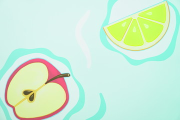 painted Apple and lemon on a green background