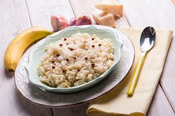 risotto with banana pink pepper and parmesan cheese