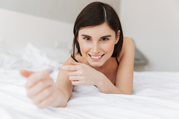 Portrait of a smiling young woman with outstretched hands