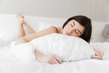 Portrait of a smiling young woman sleeping