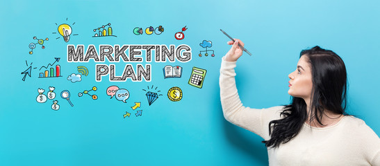 Marketing Plan with young woman holding a pen on a blue background