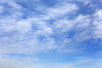 Blue sky with clouds. Beautiful heaven.