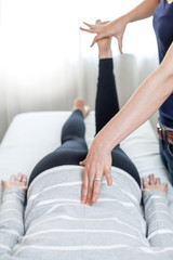 Therapist giving Kinesiology treatment.