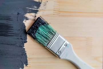 black paint on wooden background. selective focus