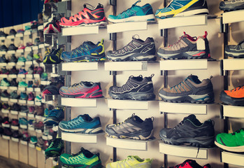 Image of large selection of sport shoes in store.