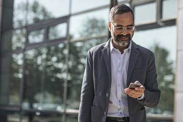 Businessman Typing on Smartphone