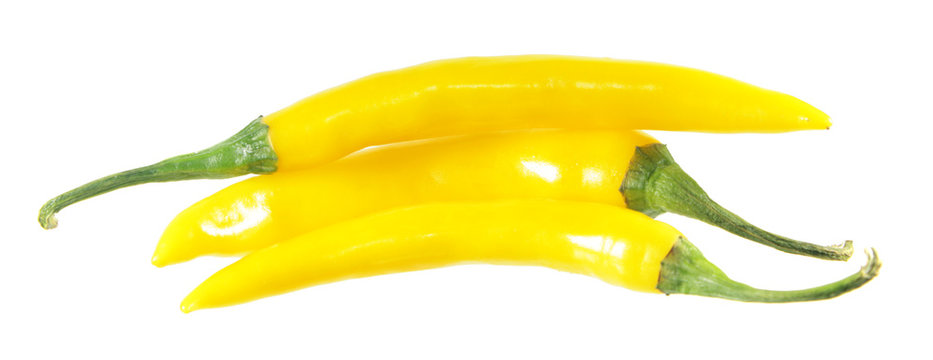 Three yellow chili peppers isolated on white background