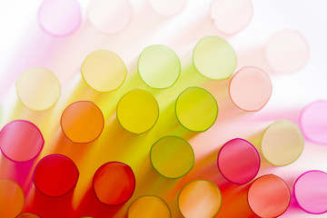 Colourful straws on a white background - macro detail