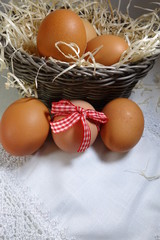 Chicken eggs  in a basket. Easter theme - Selective focus