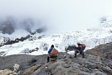 Settlers at feet of the snowy verdish