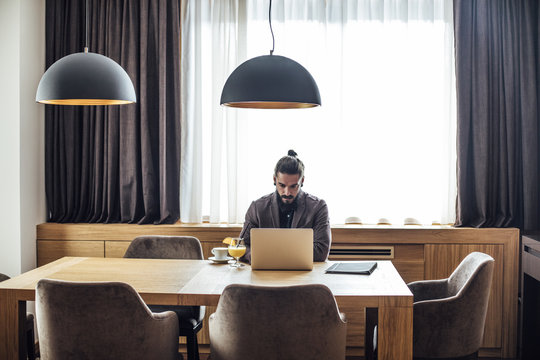 Businessman Freelancer Working From Hotel Room