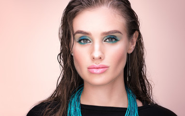 Beauty closeup portrait. Beautiful young woman with wet hair. Professional make-up, delicate clean skin