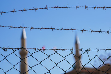 Image of barbed wire on blurred background in afternoon