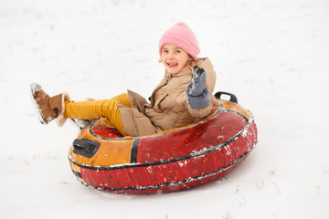 Picture of girl riding tubing in winter park