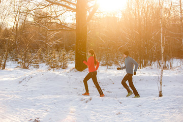 Image of sports woman and man on morning run in winter