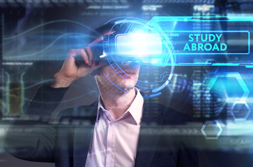 Business, Technology, Internet and network concept. Young businessman working on a virtual screen of the future and sees the inscription: Study abroad
