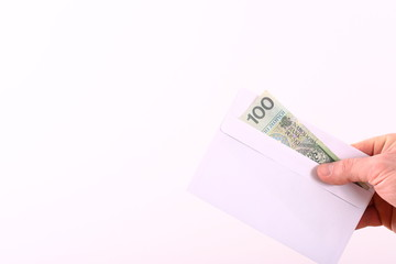 Envelope with banknote isolated on white background.